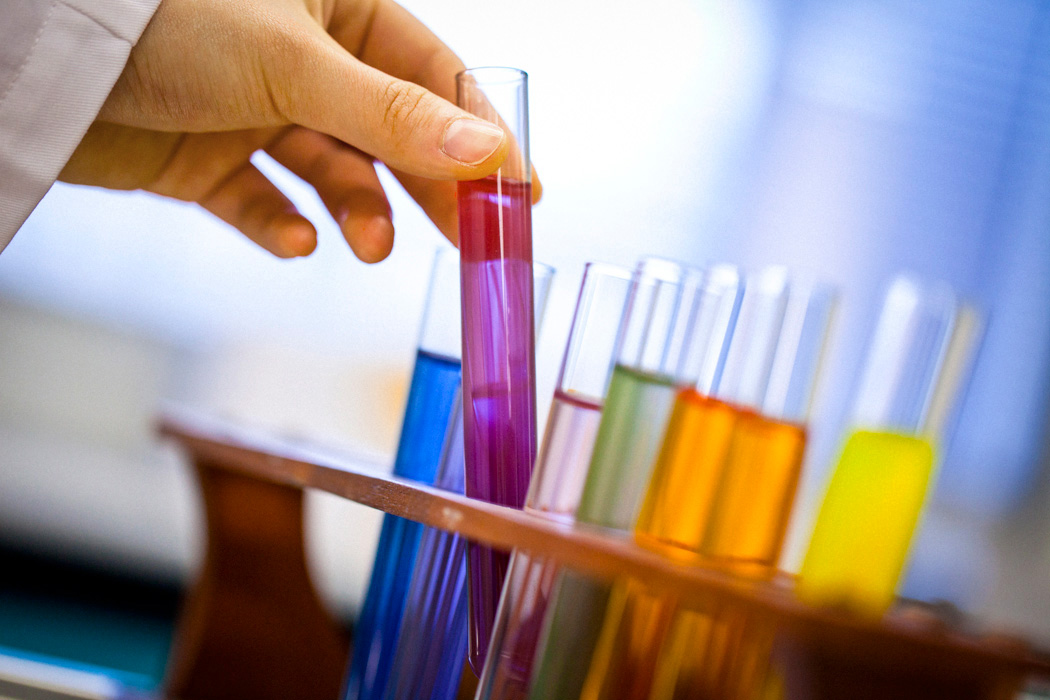 Test tubes containing coloured chemical solutions at the Science labs of the University of Technology, Sydney.