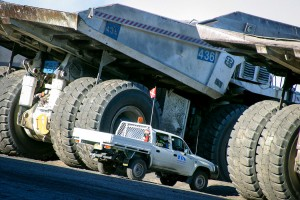 Toyota Land cruiser next to 100 tonne open cut mining trucks. Mowlem Power & Mining