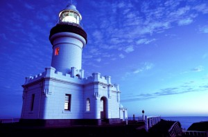 "The lighthouse in Byron Bay is at Australia's most Easterly point. In 1991, when this photograph was taken, a volcanic eruption in the Philippines was altering the weather patterns in the region and creating dramatic sunsets in Australia. A long exposure created the continuous light in the turret. The red lit window is called a ""sector light"". It is cleverly designed so that its recess points at the hazardous Julian Rocks in the bay. It is a warning to any vessel approaching in this direction."