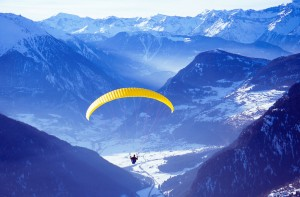 Paraglider takes off from the ski resort of Verbier in the Swiss Alps.