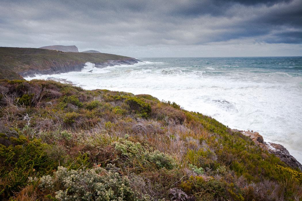 Stormy seas on the southern coastline of the Tasman Peninsula, 12 km south of Port Arthur, Tasmania.