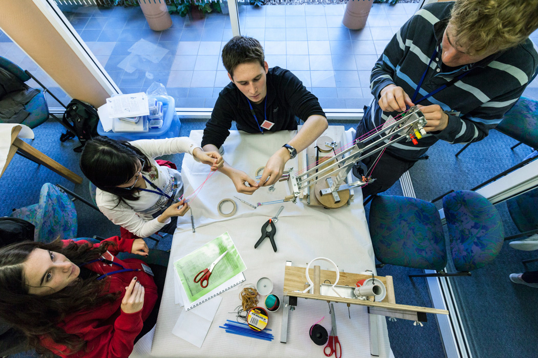 High school students at The University of Sydney's Science & Engineering Challenge. These students are taking part in a timed exercise to create a working robotic arm.
