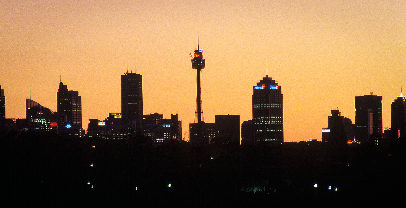 Sydney city skyline at dusk. Taken with a long telephoto lens from Marrickville.